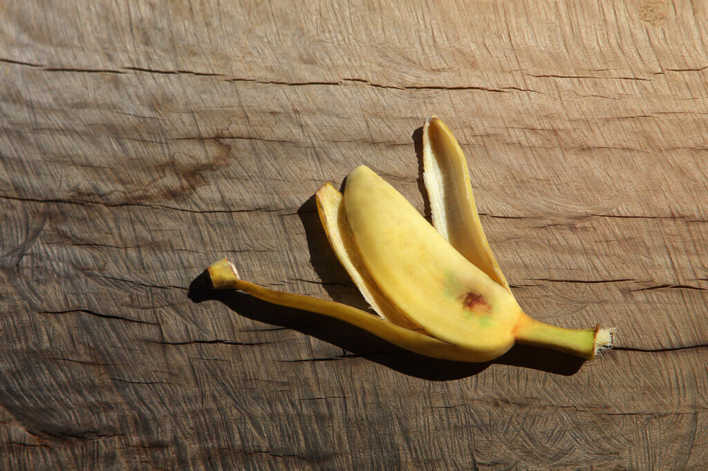 Banana peel on wood background (with clipping path). this color is retro  style